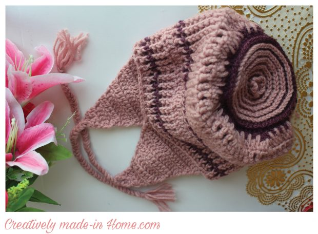 beautiful and warm crochet ear flap cap for baby
